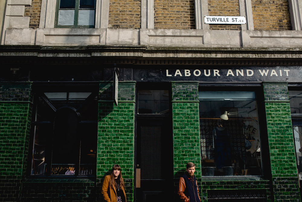 cool and modern portrait of couple outside of labour and wait shop in shoreditch