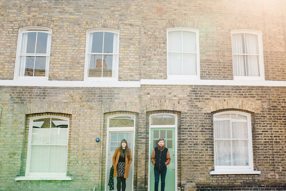 East London portrait of couple in front of victorian houses