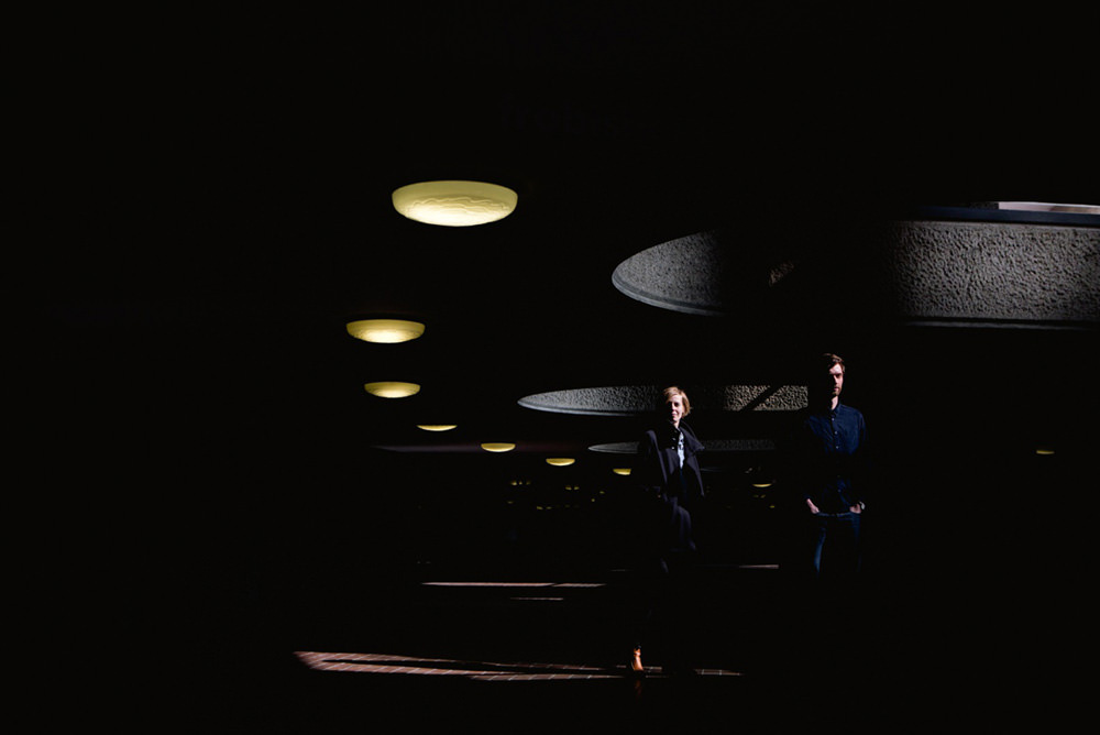 creative and modern portrait of couple at the barbican centre in london