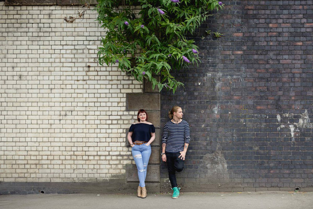 engagement session against rustic walls in leeds city centre