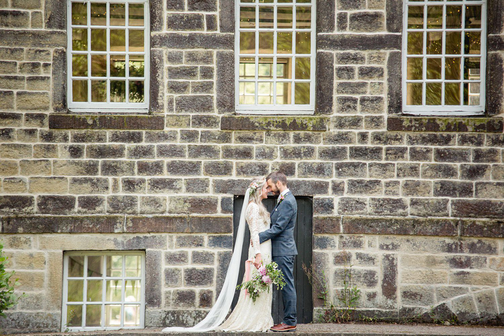 relaxed portrait in front of Gibson Mill wedding venue hebden bridge