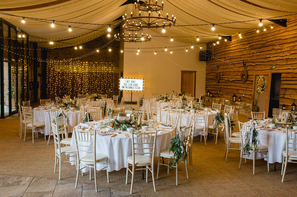 Tables set up for wedding breakfast in Hornington Manor Barn