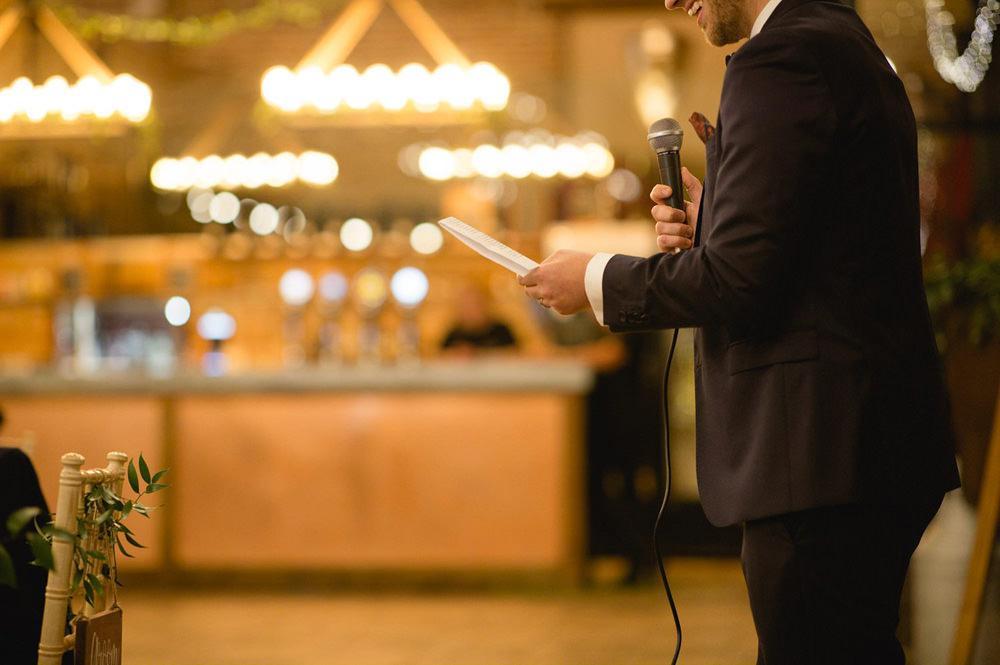 detail photo of groom reading his speech in wedding barn york