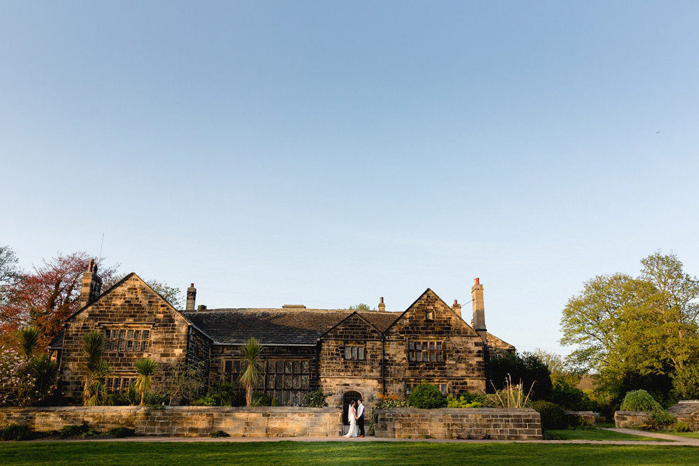 Portrait of couple at sunset outside of Oakwell Hall in Bristall