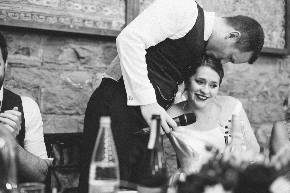 Natural Black and White photo of bride and groom during speeches