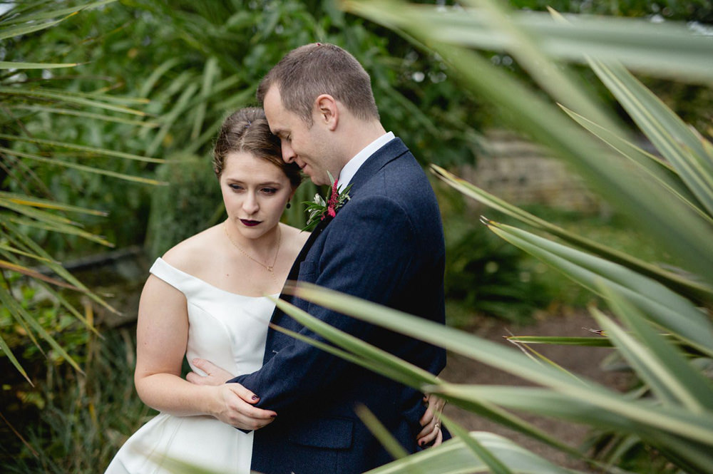 tropical portrait of couple at oakwell hall barn wedding venue