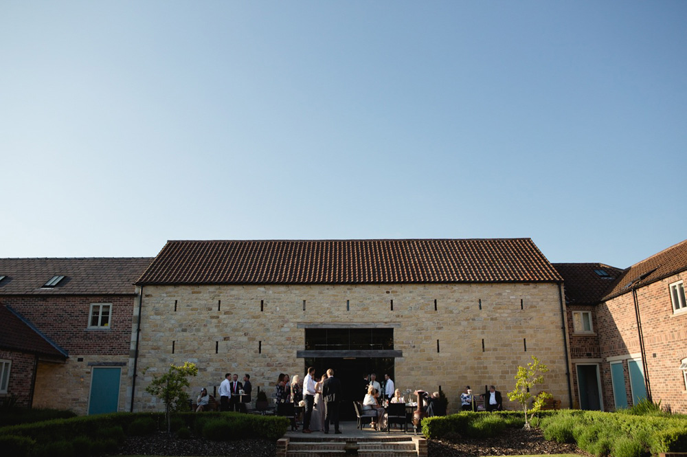 outside of the priory cottages wedding barn at dusk