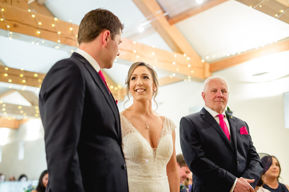 Bride and groom during wedding ceremony at Priory cottage wedding barn