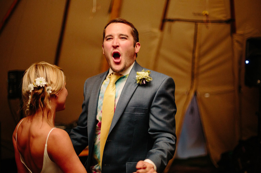 Groom dancing in tipi during his first dance