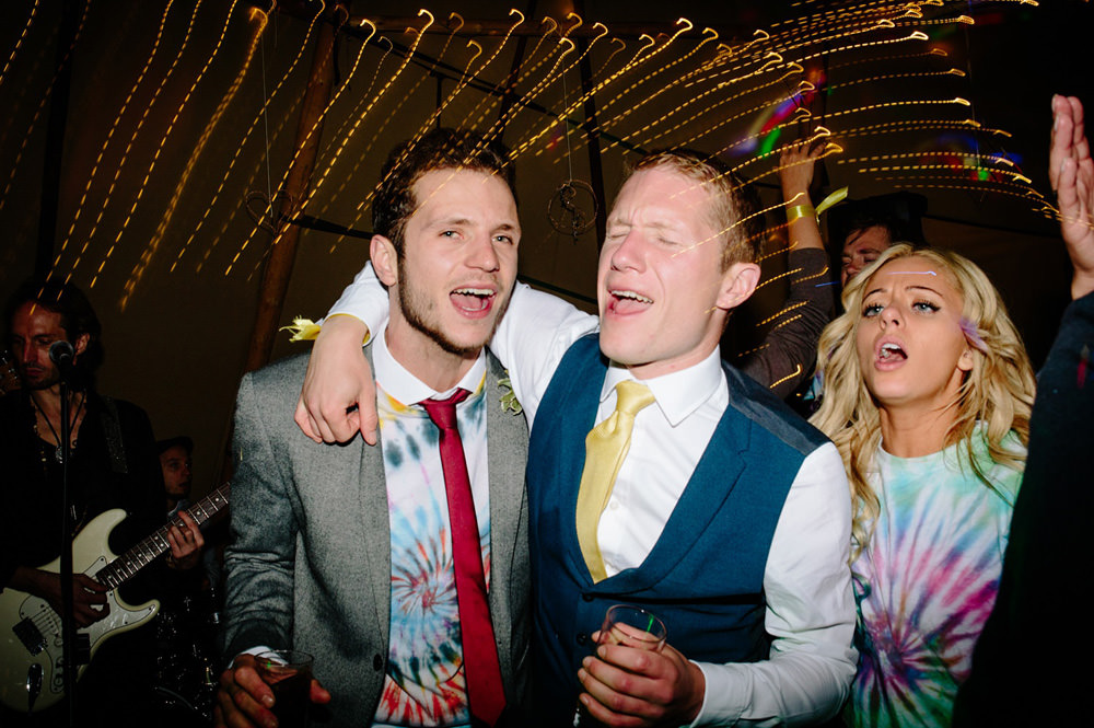 Guests enjoying themselves at tipi wedding