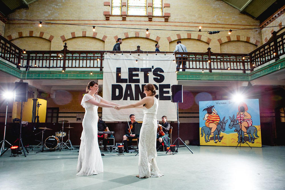 First dance in Victoria baths middle room with david bowie inspired banner