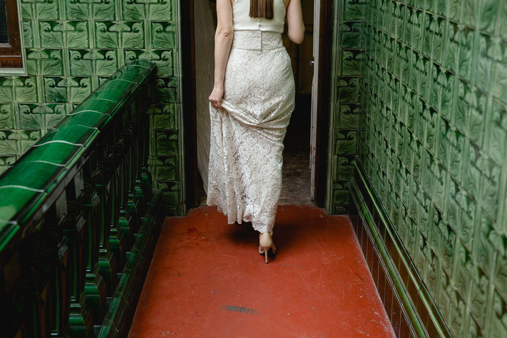 lace two piece wedding dress photographed against victoria baths tiles