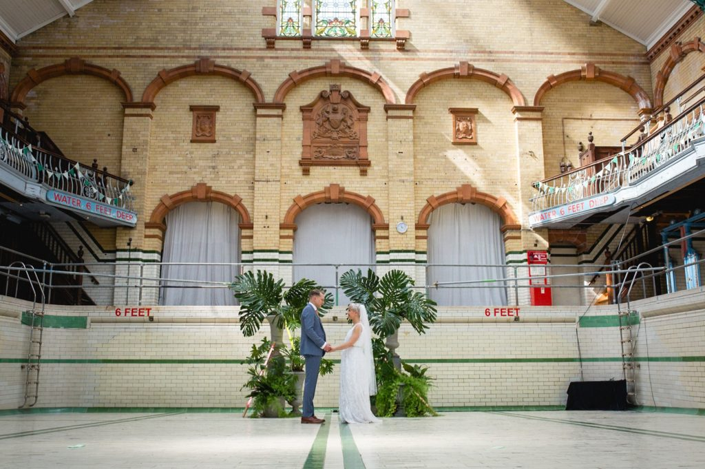 Portrait if couple in the main pool at Victoria Baths Swimming Pool wedding venue manchester