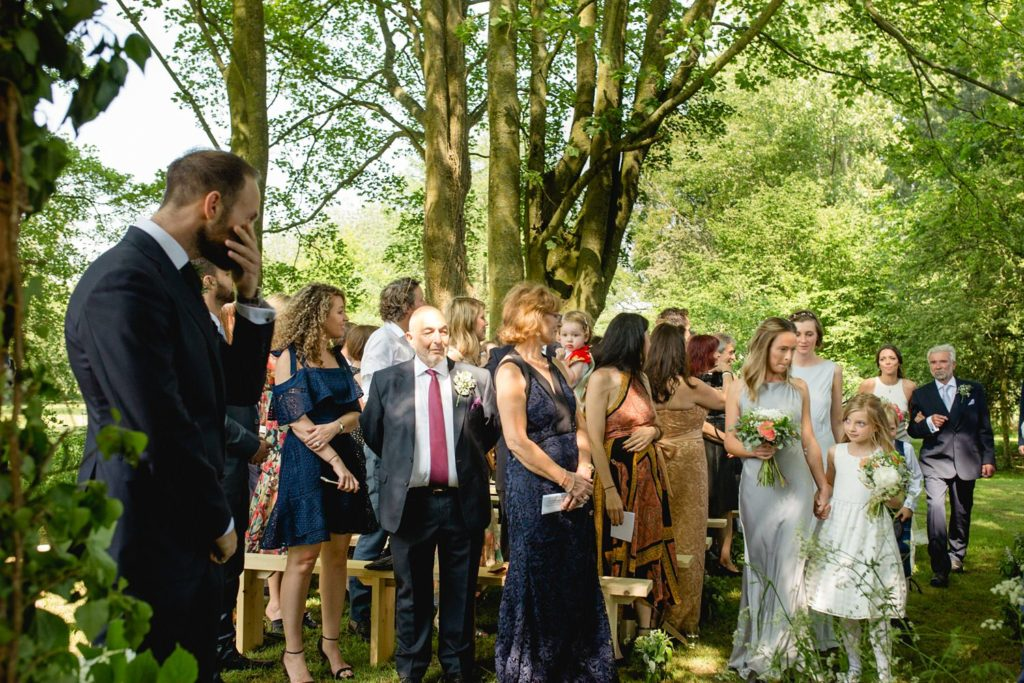 Groom seeing his bride for the first time at outdoor garden wedding kent