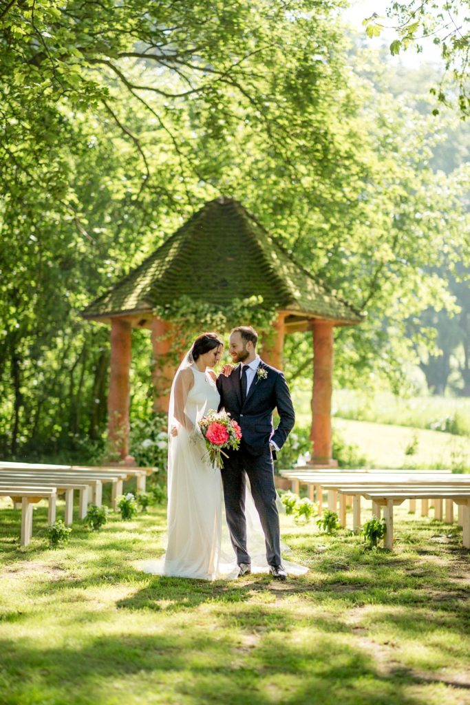Modern and beautiful portrait of couple at their outdoor garden wedding kent