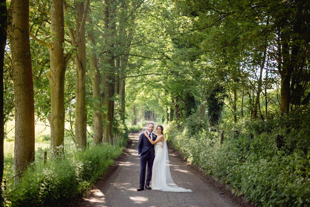 creative wedding portrait of couple in woodlands and country lane in kent