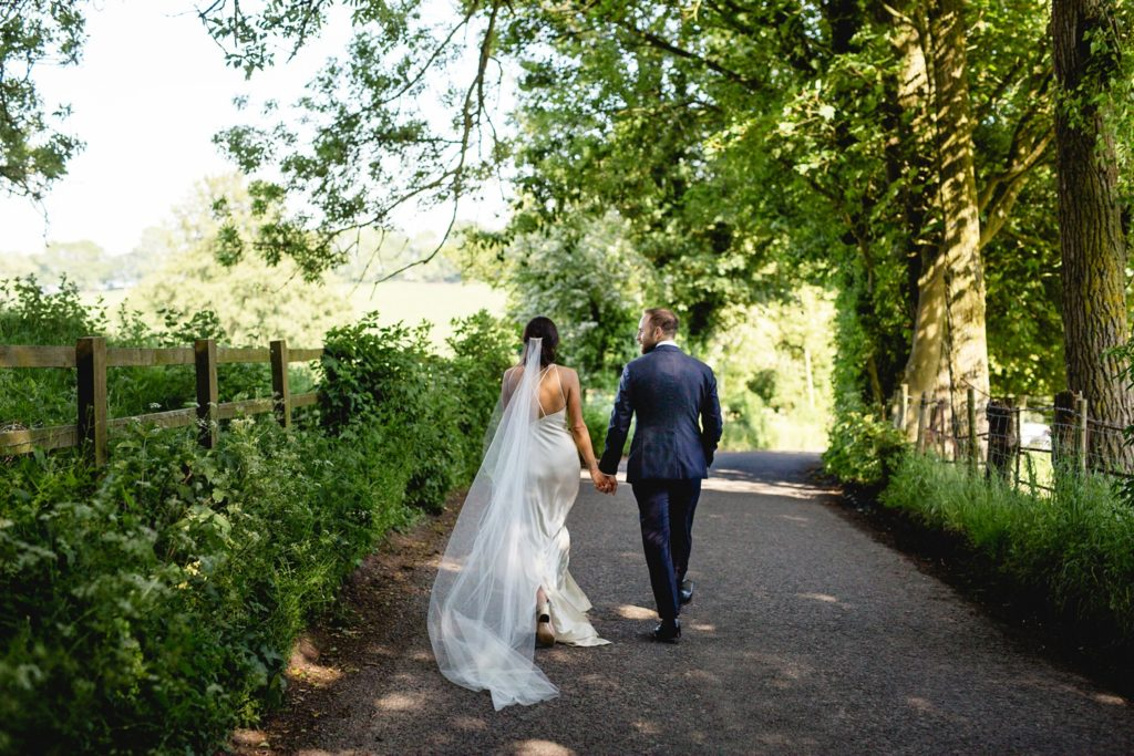 relaxed portrait of couple walking down a country lane in kent