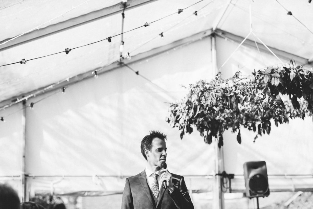 black and white photo of speeches in outdoor wedding celebrations