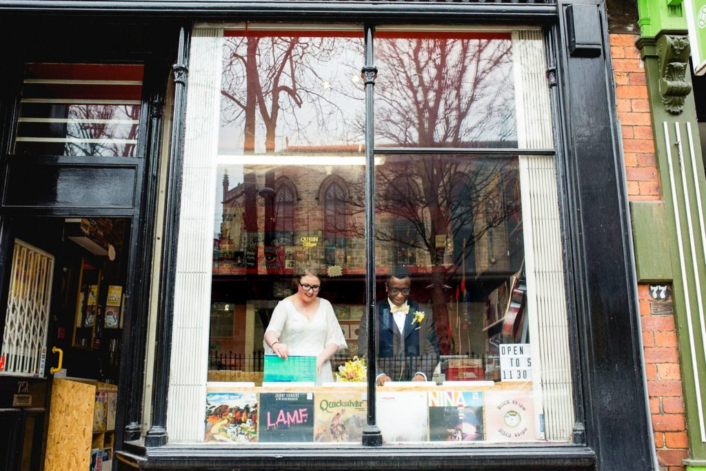 modern and quirky wedding portrait in leeds record shop