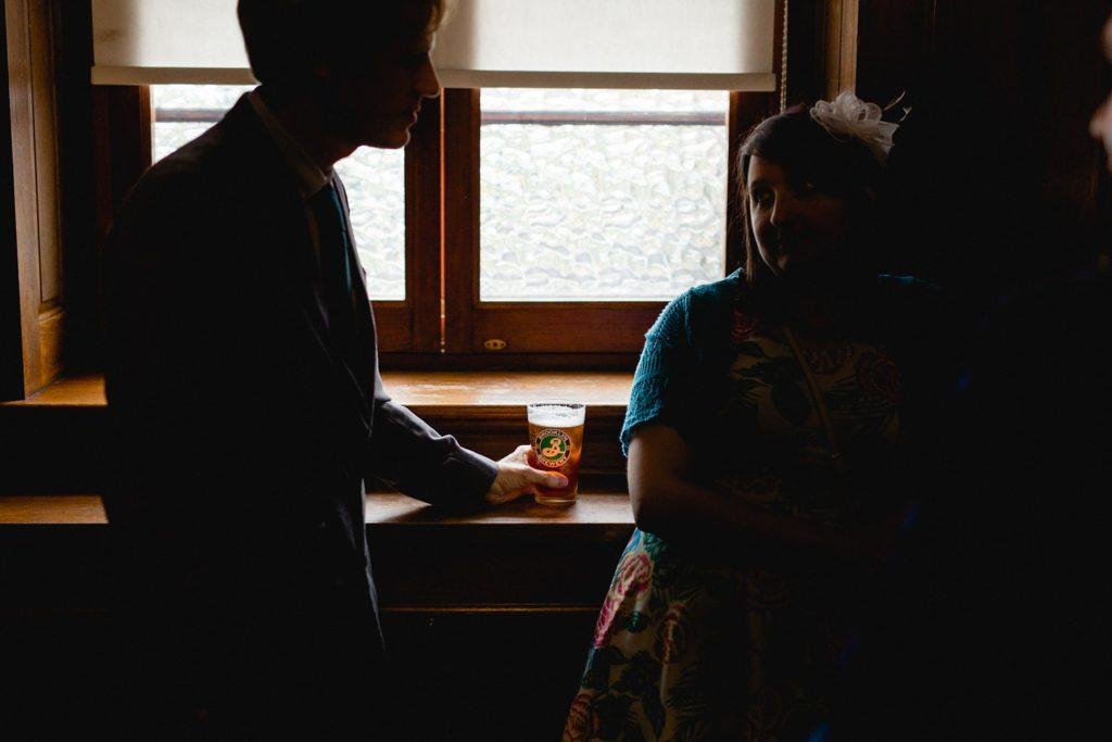 wedding guest drinking brooklyn beer at the tetley