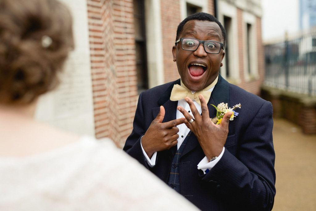 fun and quirky photo of groom outside of the tetley