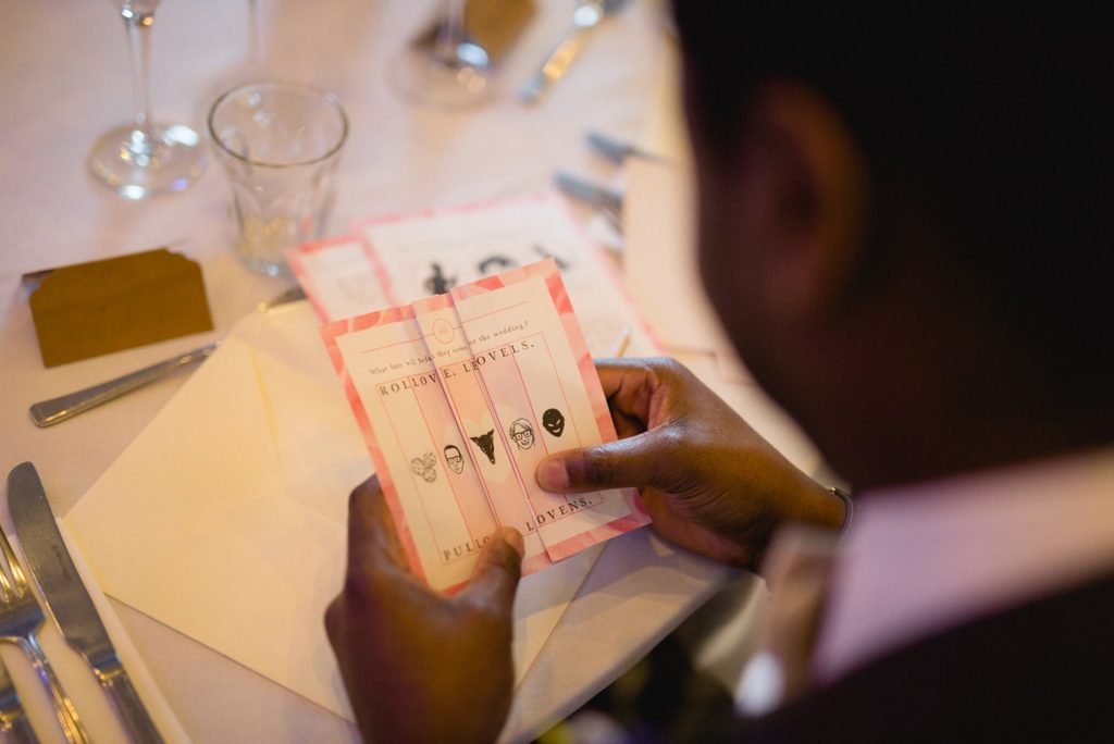 leeds documentary photograph of guest enjoying custom wedding favour book